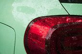 Beautiful Rain Drops On The Car Of Trendy Tranquil Dawn Or Neo Mint Color. Wet Car Body Of Trendy Tr poster