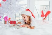 Expressive Little Girs Is Showing With Gestures And Face Expression That Mailing With Santa Is Reall poster