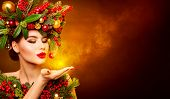 Christmas Fashion Model Beauty Makeup, Wreath Hairstyle. Xmas Woman Blowing To Hand, Beautiful Artis poster