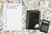 Notebook With The Word Budget And A List Of Targets, Wallet, Coins, Calculator On The Background Of  poster