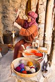 NAZARETH, ISRAEL - APRIL 24: Woman dressed as a first-century herder working old fashioned wool spin