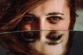 Woman Eyes Close Up Reflected In Mirror. Hypnotize Strong Look. Hypnotic Deeply Penetrating Glance.  poster
