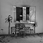 Chair Under Broken Window