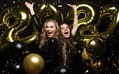 Happy Gorgeous Girls In Stylish Sexy Party Dresses Holding Gold 2020 Balloons, Having Fun At New Yea poster