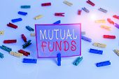 Conceptual Hand Writing Showing Mutual Funds. Business Photo Text An Investment Program Funded By Sh poster