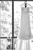 Wedding Dresses Hanging On A Hanger. Fashion Look. Interior Of Bridal Salon. Black And White Photo O poster