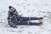 Boy Fell On Snow, Boy Slipped On The Ice And Fell Into The Snow poster