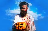 Halloween Bearded Man With Blood Make-up. Halloween Zombie Concept. Devil Man With Bloody Face. Hall poster