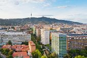 stock photo of sacred heart jesus  - view on Barcelona and Tibidabo Mountain with TV tower and Expiatory Church of the Sacred Heart of Jesus - JPG