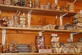 Wood Products On Shelf Of Souvenir Shop. Handicraft Of Making Wood. Wide Choice Of Wood Products On  poster