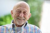 pic of 70-year-old  - Portrait of seventy years old man outdoors - JPG