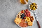 Meat And Cheese Plate.traditional Italian Antipasto, Cutting Board With Salami, Cold Smoked Meat, Pr poster