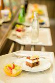 Desserts on serving tray cafeteria self service fruit salad cake