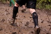 POCONO MANOR, PA - APR 28: Participants run through large areas of deep mud at Tough Mudder on April