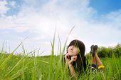 stock photo of teenage girl  - Girl lying on grass and dreams - JPG