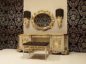 Baroque table with mirror on the wallpaper background with ornament