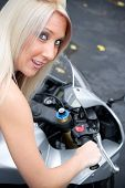 picture of crotch-rocket  - A young blonde woman poses on her motorcycle - JPG