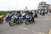 HASTINGS, ENGLAND - MAY 7: Motorcyclists ride along the seafront  during the annual May Day motorcycle rally on May 7, 2012 at Hastings, East Sussex. The event attracts thousands of riders each year.