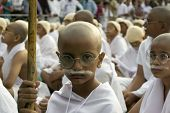 Young Boy Sitting Dressed Up As Gandhi For World Record