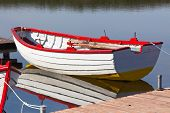 Floating Wooden Boat With Reflection