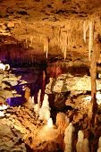 stock photo of stalagmite  - Inside view of an underground cavern or cave with stalagmites and stalactites