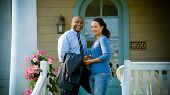 African American Couple Stand In Front Of House