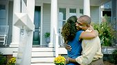 African American Couple Hug After Buying New Home