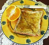 Toast And Marmalade With Knife And Orange