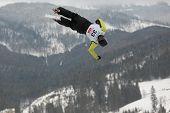 BUKOVEL, UKRAINE - FEBRUARY 23: Sergii Lysianskyi, Ukraine performs aerial skiing during Freestyle Ski World Cup in Bukovel, Ukraine on February 23, 2013.