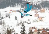 BUKOVEL, UKRAINE - FEBRUARY 23: Sergei Berestovskiy, Kazakhstan performs aerial skiing during Freestyle Ski World Cup in Bukovel, Ukraine on February 23, 2013.