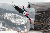 BUKOVEL, UKRAINE - FEBRUARY 23: Serhiy Berchun, Ukraine performs aerial skiing during Freestyle Ski World Cup in Bukovel, Ukraine on February 23, 2013.