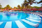 PLAYA DEL CARMEN, MEXICO - JULY 12, 2011: Scenery of luxury swimming pool at RIU Yucatan Hotel on Ju