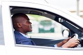 african american businessman driving to work