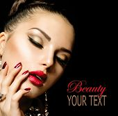 Beauty Woman with Perfect Makeup. Beautiful Professional Holiday Make-up. Red Lips and Nails. Beauty