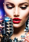Singing Woman with Retro Microphone. Beauty Glamour Singer Girl. Vintage Style. Song