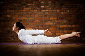 foto of pranayama  - Girl exercising yoga against brick wall - JPG