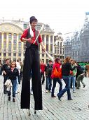Stilt Walking Man Dressed As Juggler
