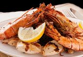 image of squid  - Jumbo prawns and grilled squids with black rice and lemon - JPG