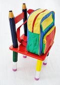 Colorful school backpack and little chair