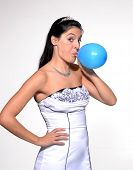 picture of blow-up  - Funny bride blowing up a balloon - JPG