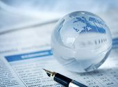 Glass globe on financial report