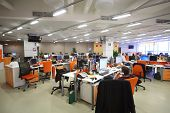 MOSCOW - MAR 5: Employees work in office buildings news agency RIA Novosti with orange furniture on
