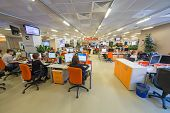 MOSCOW - MAR 5: Employees work in office buildings news agency RIA Novosti with many screens and inf