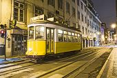 Traditional Yellow Tram Downtown Lisbon By Night