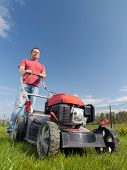 Man mowing grass with grass-mower