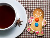 Gingerbread man with cup of tea