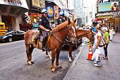 Policeofficer Is Riding His Horse Downtown New York