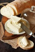 foto of margarine  - Homemade bread and piece of fresh butter - JPG