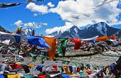 Tibetan Praying Flags Blown By The Wind With High Himalayas In The Background