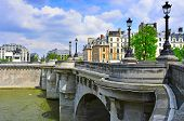PARIS, FRANC - MAY 17: The Pont Neuf bridge on May 17, 2013 in Paris, France. This is the oldest sta